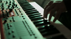 Man playing on synthesizer at a rock concert. - stock footage