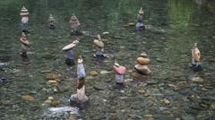 Buddhist rock garden in river. Spiritual oriental landscape background Stock Footage