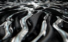 Molten Silver Seeping Out Of Rock - stock illustration