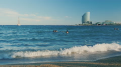 Barcelona, Spain - Beach Barcelona, people bathing in the sea on Stock Footage