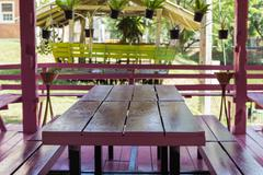 table in pink wooden gazebo - stock photo