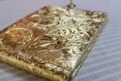 book with golden hardcover - stock photo