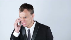 Furious businessman on the phone - stock footage