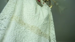 Wedding dress holding in the room.close-up Stock Footage