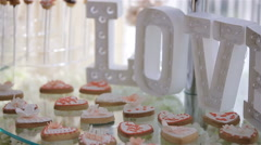 Wedding candy bar.Candy bar with cookies and colorful candy on plate for wedding - stock footage