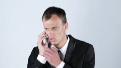 Businessman get bad news of job rejection on phone Stock Footage
