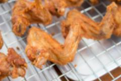 blurry image of fried chicken wing limb - stock photo