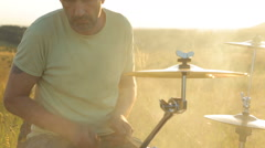 Man playing drums on nature Stock Footage