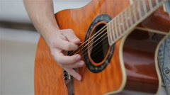 Young man playing the acoustic guitar.Close up of a guitarist playing Stock Footage