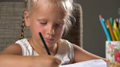 little girl performs educational tasks - stock footage