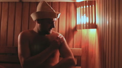 Strong caucasian man relaxing in sauna spa Stock Footage