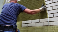 house insulation - insulating house facade with mineral rock wool - stock footage