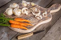 Ingredients for cooking: mushrooms, carrots and garlic - stock photo