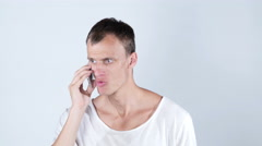 Angry handsome man getting bad news on the phone Stock Footage
