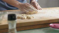 Skilled hands rolling rapidly and carefully the dough for gnocchi Stock Footage