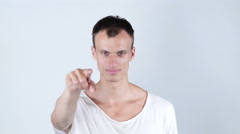 Portrait of a young man pointing his finger at you Stock Footage