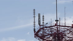 TIME-LAPSE: A telecommunication tower on a clouds background (close up) Stock Footage
