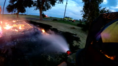 Point of view from fireman as he sprays fire hose Stock Footage