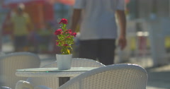 Empty table with flower in street cafe Stock Footage