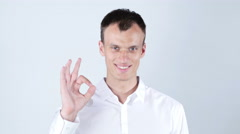 man gesturing OK sign on white background - stock footage