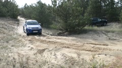 Driving Toyota cars off the road in the sand desert and forest - halp stuck car Stock Footage