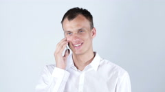Good business talk. Confident young man talking on the mobile phone and smiling Stock Footage