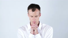Closeup portrait of young man, praying looking up hoping for best , forgiveness Stock Footage