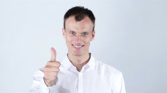 Happy man with beaming smile showing thumb up - stock footage