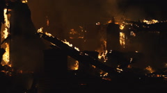 Inferno leaves house in ruins Stock Footage