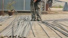 close-up metalworking straightening steel rod to make stirrup poles. - stock footage