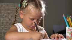 Little girl performs educational tasks Stock Footage