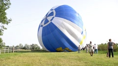 The balloon is inflated with hot air and it rises into the sky Stock Footage