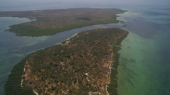 Aerial view over a tropical archipelago on a sunny day - Tanzania Stock Footage