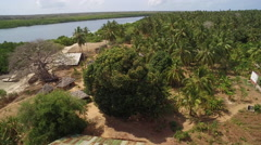 Aerial view above a fishing village with boats - Tanzania Stock Footage