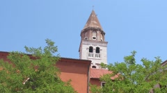 A bell tower among the trees of a park Zadar, Croatia Stock Footage