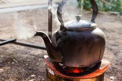 Kettle on charcoal brazier Stock Photos
