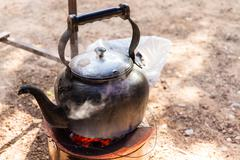 kettle on charcoal brazier - stock photo