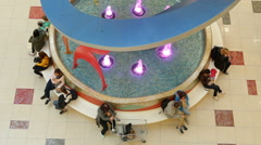 Large fountain in the Mall evropolis, near which people sit, talk, eat, and Stock Footage