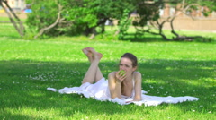 Healthy young woman eating green apple and smiling - stock footage