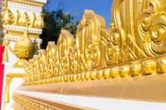 Gold tracery decoration on buddhist temple wall Stock Photos