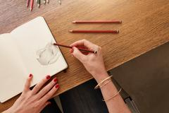 Female artist working with pencil sketch Stock Photos