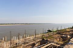 The pier beside Mekong river is under construction in Nakhon Phanom near the  Stock Photos
