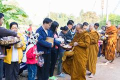 People put food on buddhist monk alms bowl Stock Photos