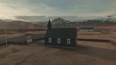 Black Church And Snowcapped Mountains During Sunset Stock Footage