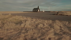 Old Black Church Amidst Landscape Stock Footage
