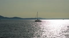boat in the sea at sunset in Zadar, Croatia - stock footage