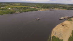 Aerial view:Tugboat on the river Stock Footage