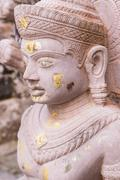 old buddha statue in antique stone castle - stock photo