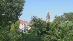 Bell tower among the trees of a park Zadar, Croatia Stock Footage