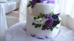 Wedding cake decorated with flowers Stock Footage